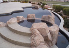 A swimming pool with large rocks